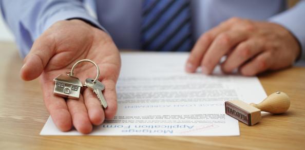Estate agent desk paperwork keys