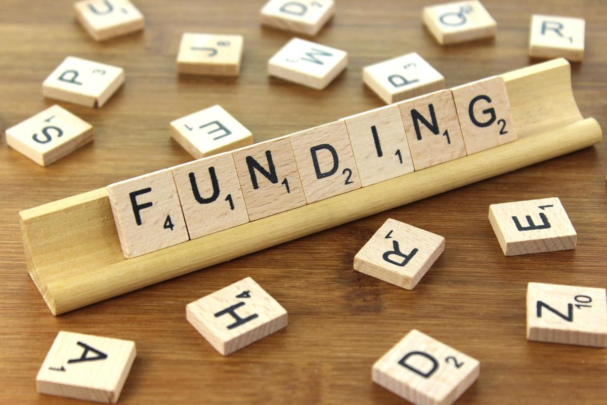 close up of scrabble tiles spelling out the word funding