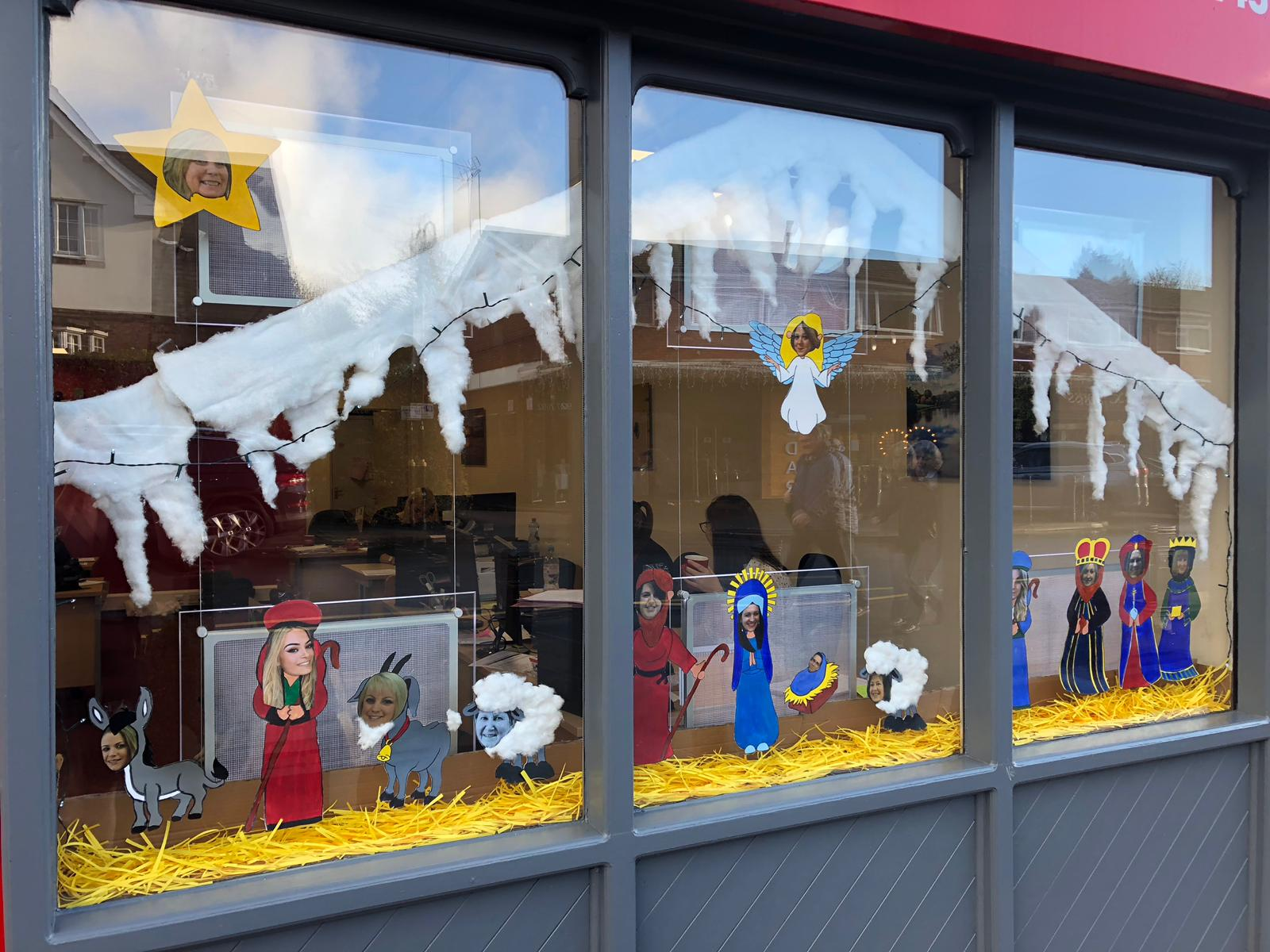 Robert Oulsnam Lettings team Christmas window display