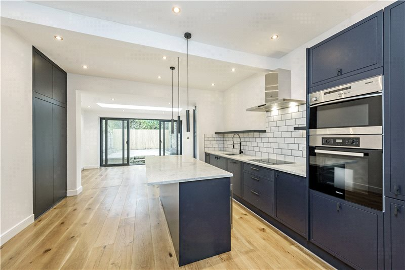 A newly refurbished four-bedroom house located in prestigious Barnes